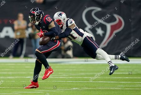 New England Patriots cornerback Jonathan Jones (31) breaks up a pass intended for Houston Texans wide receiver Kenny Stills (12) during the second half of an NFL football game, in Houston