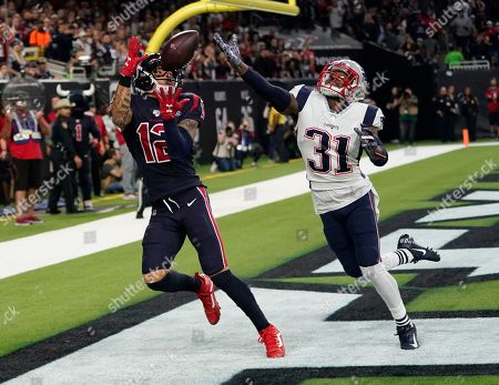 Houston Texans wide receiver Kenny Stills (12) pulls in a pass in front of New England Patriots cornerback Jonathan Jones (31) for a touchdown during the second half of an NFL football game, in Houston