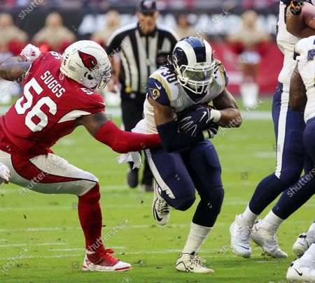Los Angeles Rams running back Todd Gurley II (C) runs past Arizona Cardinals outside linebacker Terrell Suggs (L) during the first quarter of the NFL American Football game between the Los Angeles Rams and the Arizona Cardinals in Glendale, Arizona, USA, 01 December 2019.