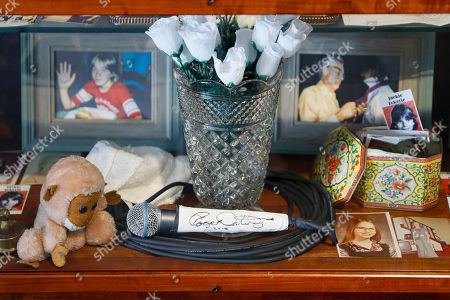 A signed microphone by The Who's Roger Daltrey is displayed in a memorial cabinet at the Finneytown High School secondary campus in Finneytown, Ohio, along with other mementoes of the three Finneytown students killed in a stampede at the band's 1979 Cincinnati concert. Tragedy four decades ago linked the British rock band to the small suburban city in Ohio. In recent years, members of the community and the band have bonded through a project to memorialize the teens