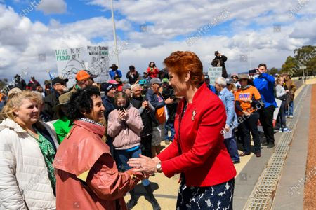One Nations Leader Pauline Hanson (R) greets farmers as they attend the 'Can the Murray-Darling Basin Plan' rally outside Parliament House in Canberra, Australian Capital Territory, Australia, 02 December 2019. A convoy of protesting farmers demonstrated on the day outside Parliament House in Canberra to demand the Murray-Darling Basin Plan be scrapped. According to protesters, the plan -- a multi billion dollars project signed into law in 2012 -- has reportedly devastated regional communities, leaving many without schools and doctors, among other services, media reported.