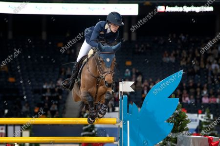 Stock Photo of Jessica Springsteen with the horse Volage du Val Henry during Sunday's grand prix jumping