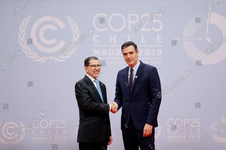 Spanish Prime Minister Pedro Sanchez (R) greets Moroccan Prime Minister Saadeddine Othmani upon his arrival for the opening ceremony of the COP25 Climate Summit held in Madrid, Spain, 02 December 2019. The UN Climate Change Conference COP25 runs from 02 to 13 December 2019 in the Spanish capital.