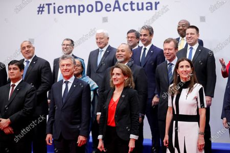 Stock Picture of Front row: Chilean Environment Minister and COP25 President, Carolina Schmidt (R), Argentine President, Mauricio Macri (2-L), Spanish Minister for Ecological Transition, Teresa Ribera (2-R), and Executive Secretary of the United Nations Framework Convention on Climate Change Patricia Espinosa (R) and Costa Rica's President, Carlos Alvarado Quesada (L), pose with other World leaders for a family picture during the opening ceremony of the UN Climate Change Conference COP25 held in Madrid, Spain, 02 December 2019. The UN Climate Change Conference COP25 runs from 02 to 13 December 2019 in the Spanish capital.