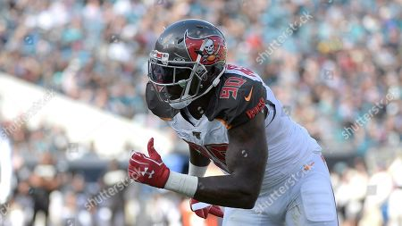 Stock Image of Tampa Bay Buccaneers linebacker Jason Pierre-Paul (90) rushes the line of scrimmage during the first half of an NFL football game against the Jacksonville Jaguars, in Jacksonville, Fla