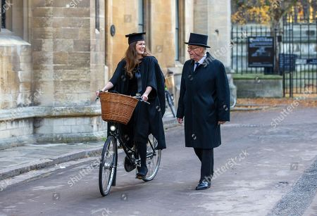 Stock Photo of Carina Tyrrell, a former Miss World finalist, with a Cambridge University proctor