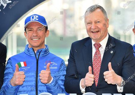 Frankie Dettori, jockey from Italy with Winfried Engelbrecht-Bresges, CEO of The Hong Kong Jockey Club.