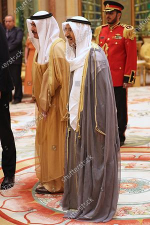The Amir of Kuwait, His Highness Sheikh Sabah Al-Ahmad Al-Jaber Al-Sabah (right), during a luncheon with Prince William at the Bayan Palace, Kuwait City