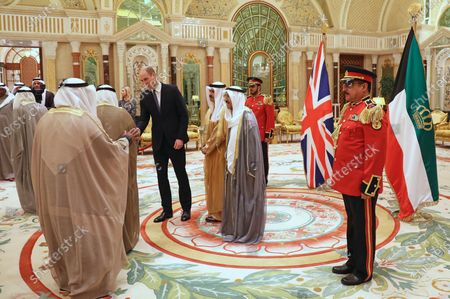 Prince William greets guests ahead of a luncheon with the Amir of Kuwait, His Highness Sheikh Sabah Al-Ahmad Al-Jaber Al-Sabah, at the Bayan Palace, Kuwait City, as part of his tour of Kuwait and Oman