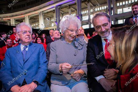 Former Italian Prime Minister Mario Monti, holocaust survivor and Italian Senator for life, Liliana Segre, President of Italian Red Cross Francesco Rocca in Milan