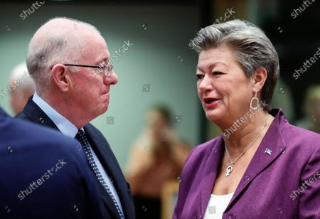 Stock Picture of Ireland's Minister of Justice and Equality Charles Flanagan (L) and European Commissioner in charge of Home affairs Ylva Johansson (R) attend a Justice and Home Affairs Council at the European Council in Brussels, Belgium, 02 December 2019.