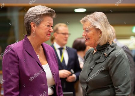 European Commissioner for Home Affairs Ylva Johansson, left, speaks with Netherland's State Secretary for Justice Ankie Broekers-Knol during a meeting of EU Interior ministers at the EU Council building in Brussels