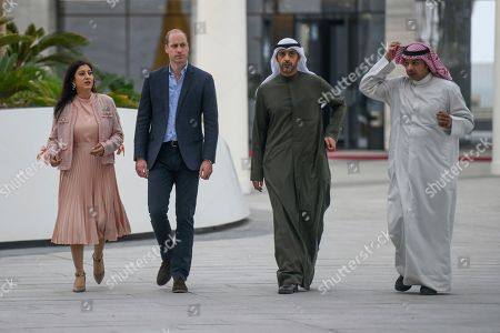 William, Mohammad Abdullah Al-Mubarak Al-Sabah. Prince William Duke of Cambridge, second left, visits the Sheikh Abdullah Al Salem Cultural Center with Kuwaiti Deputy Minister of Amiri Diwan Affairs Sheikh Mohammad Abdullah Al-Mubarak Al-Sabah, center, in Kuwait City, Kuwait