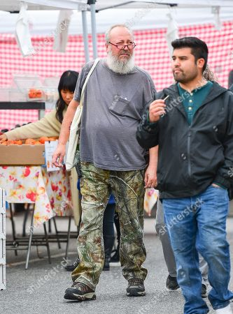 Stock Image of Randy Quaid at the farmers market