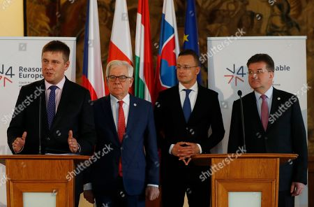 Czech Republic's Foreign Minister Tomas Petricek, left, addresses media together with his counterparts Jacek Czaputowicz of Poland, 2nd left, Miroslav Lajcak of Slovakia, right, and Peter Szijjarto of Hungary, 2nd right, during their joint press in Prague, Czech Republic