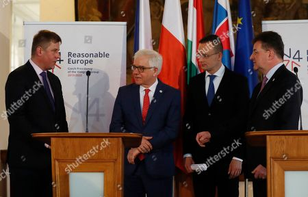 Czech Republic's Foreign Minister Tomas Petricek, left, talks to his counterparts Jacek Czaputowicz of Poland, 2nd left, Miroslav Lajcak of Slovakia, right, and Peter Szijjarto of Hungary, 2nd right, after their joint press in Prague, Czech Republic