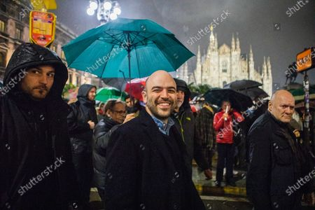Stock Picture of Roberto Saviano attends at the protest of the Movement ' Le Sardine' in Duomo square in Milan