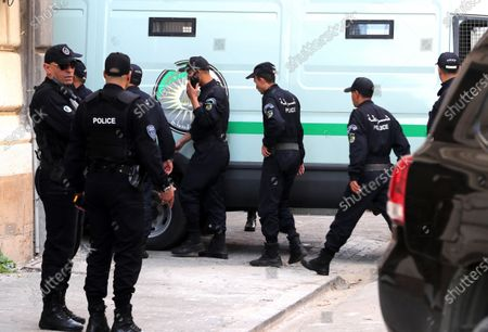 Algerian policemen stand next to a police vehicle carrying the two Algerian former Prime Ministers Abdelmalek Sellal and Ahmed Ouyahia at the Court of Sidi Mhamed of Algiers, Algeria, 02 December 2019. The two former prime ministers under the Bouteflika regime will appear before the judge on charges of money laundering and corruption.