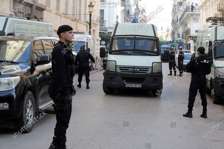 A police vehicle carrying the two Algerian former Prime Ministers Abdelmalek Sellal and Ahmed Ouyahia arrives at the Court of Sidi Mhamed of Algiers, Algeria, 02 December 2019. The two former prime ministers under the Bouteflika regime will appear before the judge on charges of money laundering and corruption.