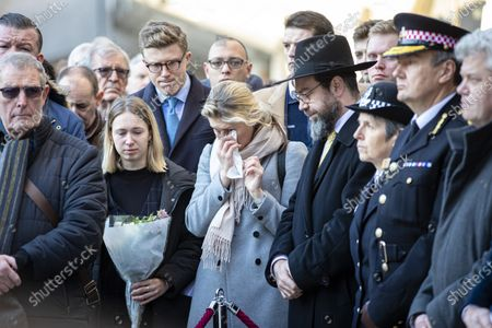 Metropolitan Police Commissioner Cressida Dick (3-R), faith leaders and members of the public attend a vigil at Guildhall Yard following a terrorist attack on London Bridge in which two people were killed.