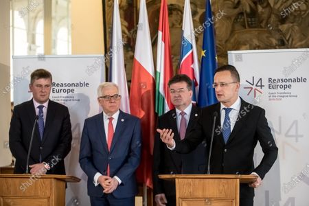 (L-R) Czech Foreign Minister Tomas Petricek, Polish Foreign Minister Jacek Czaputowicz, Hungarian Minister of Foreign Affairs and Trade Peter Szijjarto and Slovakian Foreign Minister Miroslav Lajcak attend a press conference after the Visegrad Group (V4) Foreign Ministers meeting in Prague, Czech Republic, 02 December 2019.
