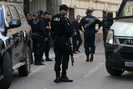 Riot police officers patrol outside the court house as two former Algerian prime ministers, Ahmed Ouyahia and Abdelmalek Sellal, go on trial on corruption charges in a much-awaited public trial amid a protest movement seeking to push out the powers-that-be, Monday Dec.2, 2019 in Algiers
