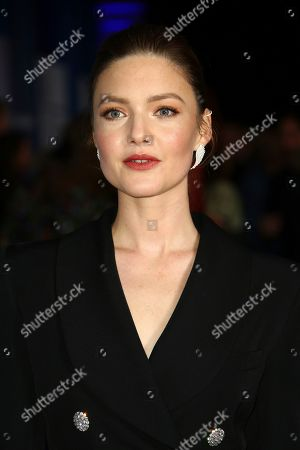 Holliday Grainger poses for photographers upon arrival at the British Independent Film Awards in central London