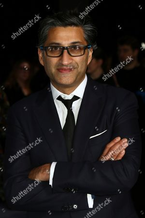 Asif Kapadia poses for photographers upon arrival at the British Independent Film Awards in central London