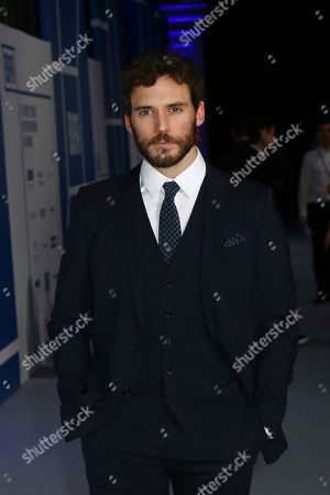 Sam Claflin poses for photographers upon arrival at the British Independent Film Awards in central London