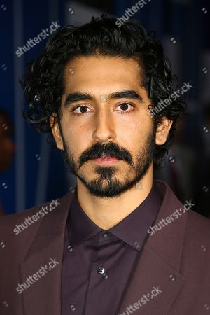 Dev Patel poses for photographers upon arrival at the British Independent Film Awards in central London