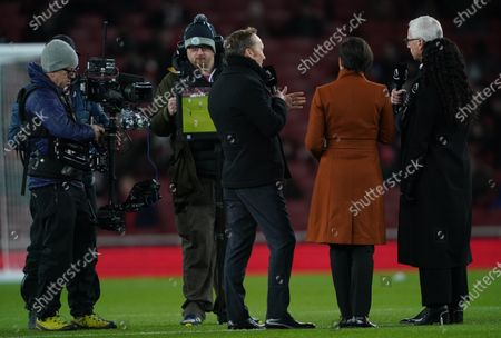Stock Picture of Presenters including Alan Pardew, Lee Dixon and Eni Aluko, cameramen and sound technicians for the Premier League's newest broadcasters, Amazon Prime Video on the pitch