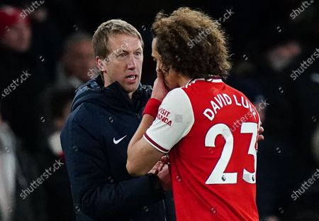 Brighton & Hove Albion Manager Graham Potter shakes hands with a dejected David Luiz of Arsenal after the game