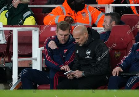 Arsenal caretaker manager Freddie Ljungberg talks tactics with assistant coach Per Mertesacker