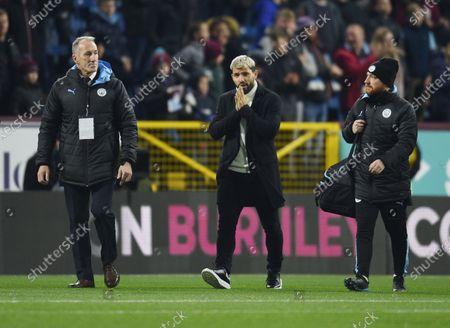 Sergio Aguero of Manchester City walks across the pitch.