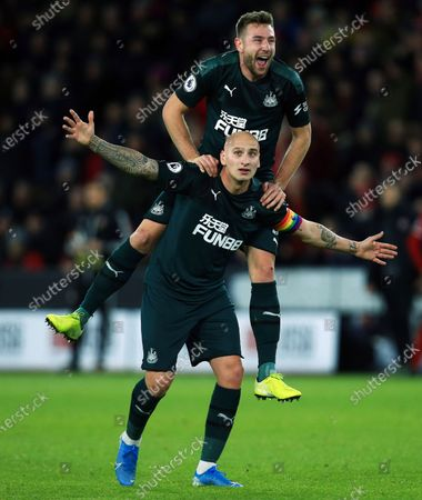 Jonjo Shelvey of Newcastle United celebrates scoring a goal to make it 0-2 with Paul Dummett after a VAR review