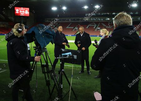 Amazon Prime Premier League presenter Catherine Whitaker and pundits Les Ferdinand and Jermaine Jenas share a joke ahead of the game