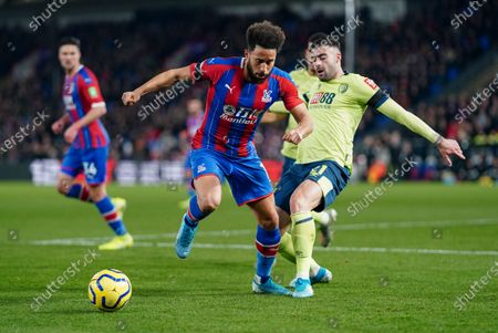 Andros Townsend of Crystal Palace is tackled by Diego Rico of Bournemouth