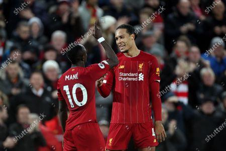 Sadio Mane and Virgil van Dijk of Liverpool celebrate their sides fourth goal to make the score 4-1
