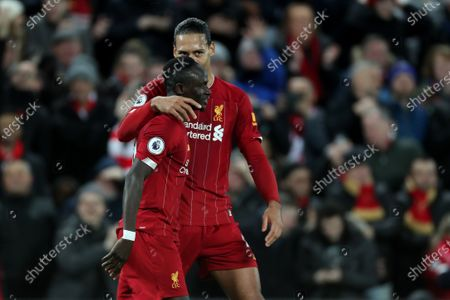 Virgil van Dijk of Liverpool congratulates goal scorer Sadio Mane after he scores the fourth goal to make the score 4-1
