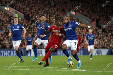 Sadio Mane of Liverpool is tackled by Djibril Sidibe of Everton