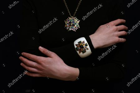 Stock Image of A multi gem-set pendant / necklace by Verdura and a limited edition enamel multi gem-set cuff by Vendura owned by Barbara Taylor Bradford