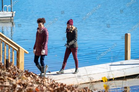 Stock Image of Rochelle Aytes as Scarlett and Jessica Collins as Monica