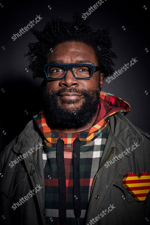 "This photo shows Questlove posing for a portrait in New York to promote his cookbook ""Mixtape Potluck"