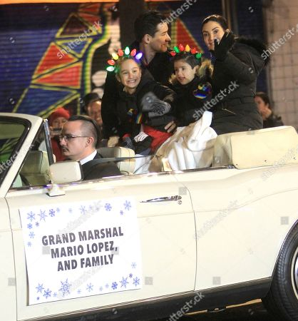 Mario Lopez led the 88th annual Hollywood Christmas Parade as grand marshal alongside his wife Courtney Mazza and kids Dominic, six, and Gia, nine.