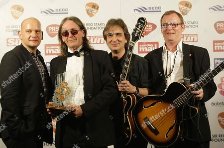 Dougie McLean who won  the Homecoming Scotland Award seen with  Greg Kane and his band