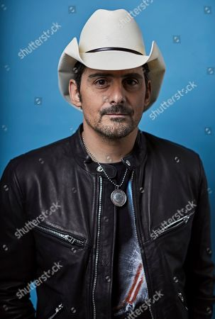 "This photo shows country singer Brad Paisley posing for a portrait in New York to promote his new variety special, "" Brad Paisley Thinks He's Special,"" airing Dec. 3 at 8 p.m. EST on ABC"