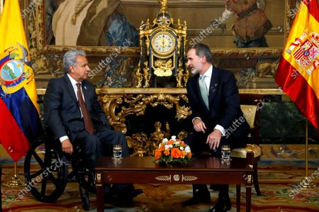 Spain's King Felipe VI (R) and President of Ecuador Lenin Moreno (L) talk during their meeting at the Royal Palace in Madrid, Spain, 02 December 2019. Medina is on official visit on occasion of the UN Climate Change Conference COP25 running from 02 to 13 December 2019 in the Spanish capital.