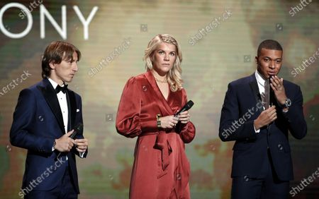 Winners of 2018 (from left) Luka Modric, Ada Hegerberg and Kylian Mbappe address attendees of the Ballon d'Or ceremony at Theatre du Chatelet in Paris, France, 02 December 2019.