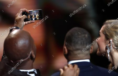 Hosts of the Ballon d'Or ceremony Sandy Heribert (R) and Didier Drogba take a selfie with the 2018 Kopa Trophy winner Kylian Mbapp (C) during the show at the Theatre du Chatelet in Paris, France, 02 December 2019.