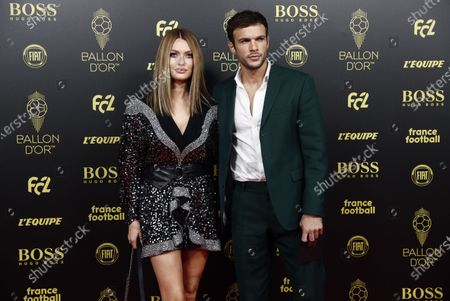 Stock Photo of French blogger Caroline Receveur (L) and French model Hugo Philip (R) arrive for the Ballon d'Or ceremony at Theatre du Chatelet in Paris, France, 02 December 2019.
